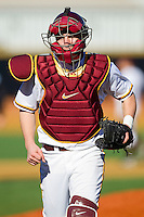 Catcher Matt Halloran #6 of the Minnesota Golden Gophers makes his first start behind the plate against the Towson Tigers at Gene Hooks Field on February 26, 2011 in Winston-Salem, North Carolina.  The Gophers defeated the Tigers 6-4.  Photo by Brian Westerholt / Four Seam Images
