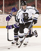 Nick Finn (HC - 26), Alex Grieve (Bentley - 23) - The Bentley University Falcons defeated the College of the Holy Cross Crusaders 3-2 on Saturday, December 28, 2013, at Fenway Park in Boston, Massachusetts.