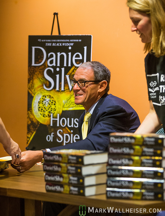 Daniel Silva, a non-fiction author, signs books after speaking at  Temple Israel in Tallahassee, FL.  Silva, who's new book House of Spies, reached #1 today sold 250 books at the event.