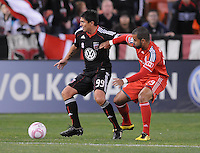 DC United forward Jaime Moreno (99) shield the ball against Toronto FC forward Maicon Santos (29).  Toronto FC. defeated DC United 3-2 at RFK Stadium, October 23, 2010.