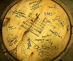 Signatures on a Four Roses barrel include one from Fred Minnick