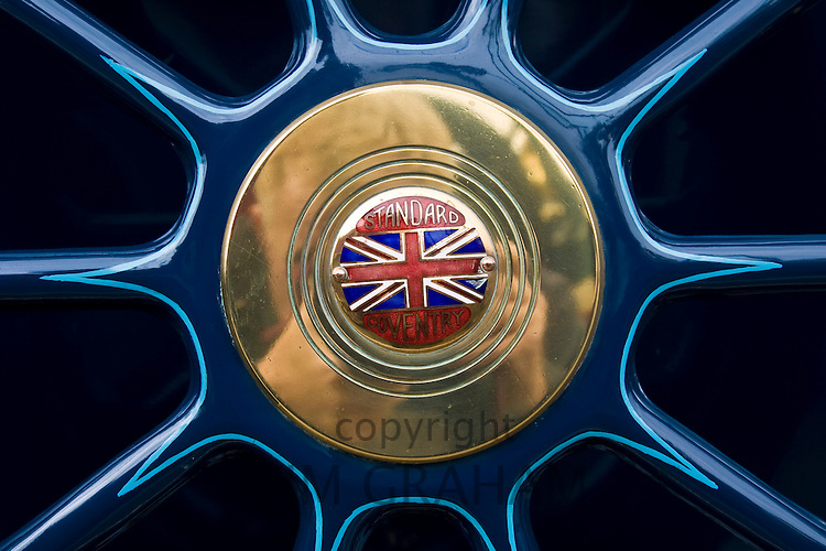 Emblem on spare wheel of vintage Standard car made in Coventry, Gloucestershire, United Kingdom