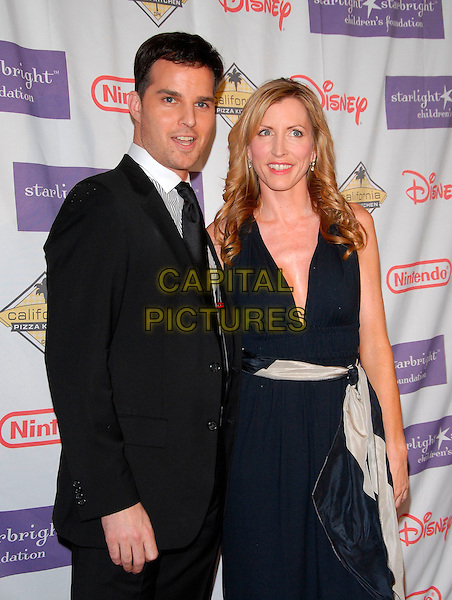 JONATHAN ROBERTS & HEATHER MILLS.At the 2007 Starlight Starbright Children's Foundation Gala held at the Beverly Hilton Hotel in Beverly Hills, California, USA, March 23 2007..half length black dress scarf belt.CAP/DVS.©Debbie VanStory/Capital Pictures