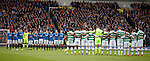 Rangers and Celtic players observe a minutes silence