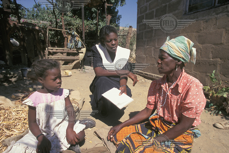 © Giacomo Pirozzi / Panos Pictures..ZAMBIA..Health worker visiting a woman who looks after orphans whose parents have died of AIDS.
