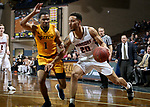 SIOUX FALLS, SD - MARCH 8:  Nic Williams #20 from Indiana Tech drives by Brandon Shingles #1 from West Virginia University Tech at the 2018 NAIA DII Men's Basketball Championship at the Sanford Pentagon in Sioux Falls. (Photo by Dave Eggen/Inertia)