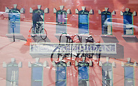 A bicyclist reflects in the window of the New Sheridan Hotel in Telluride, Colo., where a painting of the building's facade is displayed, Friday, Oct. 20, 2006. Telluride is a popular destination ski resort with a rising number of residential condominiums under construction. (Kevin Moloney for the New York Times)