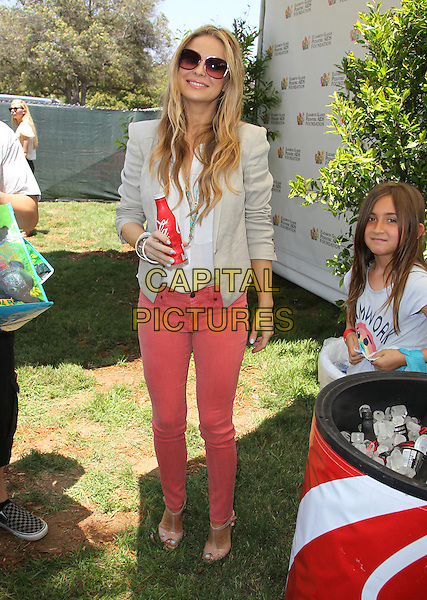 Carmen Electra.Elizabeth Glaser Pediatric AIDS Foundation's 23rd Annual 'A Time For Heroes' Celebrity Picnic held at The Wadsworth Theater, Los Angeles, California, USA..3rd June 2012.full length top white jeans denim beige blazer jacket sunglasses shades coke coca cola bottle drink beverage .CAP/ADM/FS.©Faye Sadou/AdMedia/Capital Pictures.