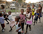 Earthquake aftermath in Cité Soleil, Haiti on Sunday, January 24, 2010. Haitian children and adults rush to get food and water as a Brazilian battalion and the U.S. Army join forces to distribute aid.