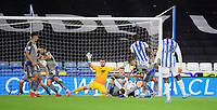 Lincoln City's Neal Eardley blocks a shot at goal from Huddersfield Town's Juninho Bacuna<br /> <br /> Photographer Chris Vaughan/CameraSport<br /> <br /> The Carabao Cup First Round - Huddersfield Town v Lincoln City - Tuesday 13th August 2019 - John Smith's Stadium - Huddersfield<br />  <br /> World Copyright © 2019 CameraSport. All rights reserved. 43 Linden Ave. Countesthorpe. Leicester. England. LE8 5PG - Tel: +44 (0) 116 277 4147 - admin@camerasport.com - www.camerasport.com