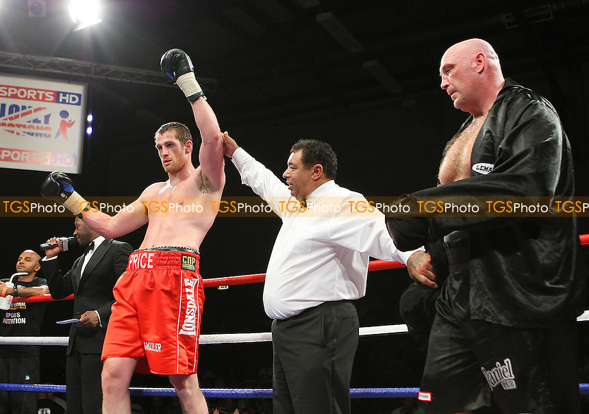 David Price (red shorts) defeats Daniil Peretyatko in a Heavyweight boxing contest at Goresbrook Leisure Centre, Dagenham, promoted by Frank Maloney - 14/05/10 - MANDATORY CREDIT: Gavin Ellis/TGSPHOTO - Self billing applies where appropriate - Tel: 0845 094 6026