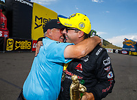 Jul 23, 2017; Morrison, CO, USA; NHRA pro stock driver Drew Skillman (right) celebrates with winner chassis builder Jerry Haas after winning the Mile High Nationals at Bandimere Speedway. Mandatory Credit: Mark J. Rebilas-USA TODAY Sports