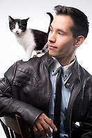 Well dressed young man with kitten on his shoulders, Maine, USA