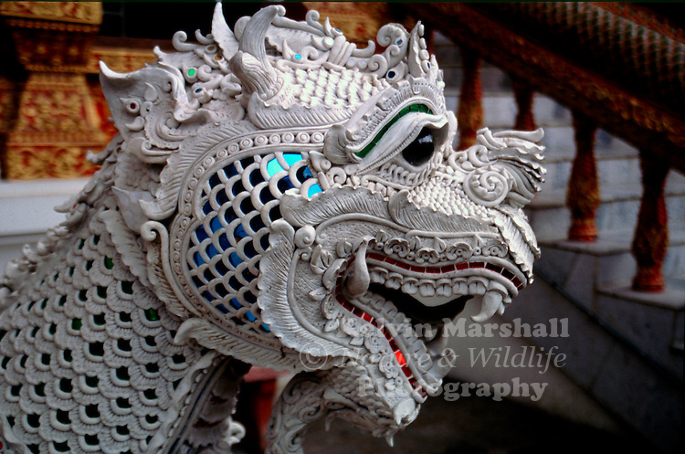 Hand carved stone statue depicting a Khmer lion at the entrance to a local temple. Chiang Mai - Northern Thailand.