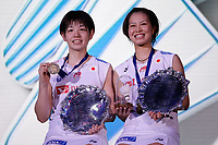 15th March 2020, Arena Birmingham, Birmingham, UK;  Japans Fukushima Yuki and Hirota Sayaka pose on the podium during the trophy presentation ceremony after winning the womens doubles final match against Chinas Du Yue and Li Yinhui at All England Open 2020 badminton tournament in Birmingham
