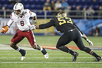 Annapolis, MD - December 27, 2016: Temple Owls quarterback Phillip Walker (8) avoids Wake Forest Demon Deacons defensive lineman Duke Ejiofor (53) tackle during game between Temple and Wake Forest at  Navy-Marine Corps Memorial Stadium in Annapolis, MD.   (Photo by Elliott Brown/Media Images International)