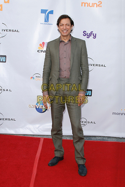 JEFF GOLDBLUM . arriving at the The Cable Show 2010 To Feature An Evening With NBC Universal held at  Universal Studios Hollywood in Universal City, California, USA, .May 12th, 2010..full length grey gray green suit shirt .CAP/ROT/AMB.©Adriana M. Barraza /Roth Stock/Capital Pictures