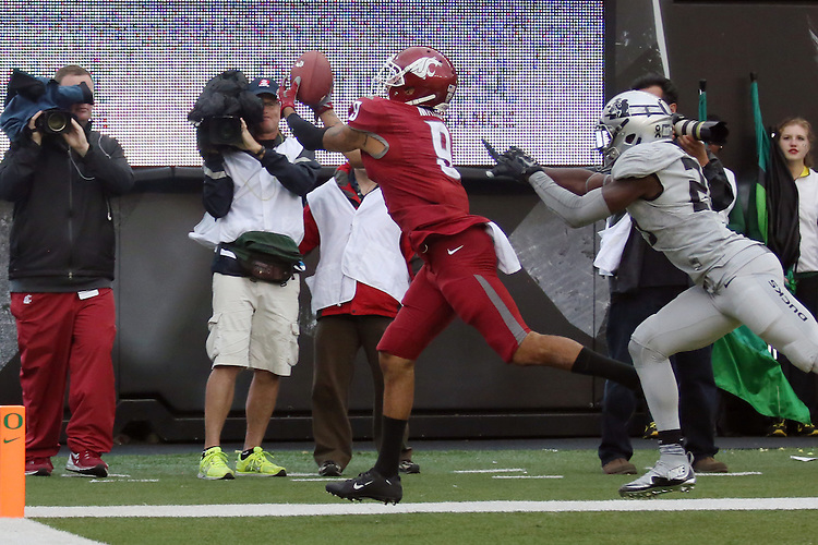 Gabe Marks (9), Washington State University wide receiver, hauls in a touchdown pass during the Cougars Pac-12 conference road game against the Oregon Ducks at Autzen Stadium in Euguene, Oregon, on October 10, 2015.  After tying the game in closing seconds of the fourth quarter, the Cougars defeated the Ducks in double overtime, 45-38.