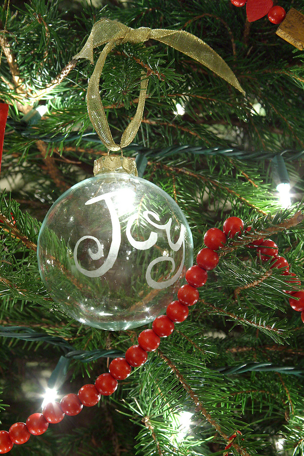 Joy ornament on Christmas tree