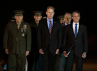 Members of the Official Party, including Governor John Carney (Democrat of Delaware), US Marine Corps General Robert B. Neller, Commandant of the Marine Corps, acting US Secretary of Defense Patrick M. Shanahan, and US Senator Tom Carper (Democrat of Delaware), pay their respects during the Dignified Transfer of the remains of United States Marine Corps Staff Sergeant Christopher A. Slutman at Dover Air Force Base in Dover, Delaware on April 11, 2019.  Members of the Official Party, including Governor John Carney (Democrat of Delaware), Sergeant Major of the United States Marine Corps Ronald Green, US Marine Corps General Robert B. Neller, Commandant of the Marine Corps, acting US Secretary of Defense Patrick M. Shanahan, and US Air Force Colonel Matthew Jones, 436th Airlift Wing, Vice Commander, pay their respects during the Dignified Transfer of the transfer case containing the remains of United States Marine Corps Staff Sergeant Christopher A. Slutman at Dover Air Force Base in Dover, Delaware on April 11, 2019. He died as the result of a road-side bomb in Afghanistan on April 8, 2019.  Staff Sergeant Slutman, a decorated 15 year veteran of the Fire Department of New York (FDNY), was married and had three children. Photo Credit: Ron Sachs/CNP/AdMedia