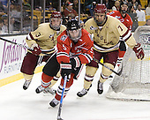 Patch Alber (BC - 3), Garrett Vermeersch (Northeastern - 9), Isaac MacLeod (BC - 7) - The Boston College Eagles defeated the Northeastern University Huskies 7-1 in the opening round of the 2012 Beanpot on Monday, February 6, 2012, at TD Garden in Boston, Massachusetts.