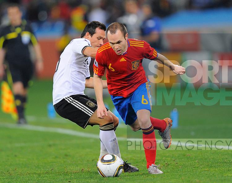Andres Iniesta of Spain skips past Piotr Trochowski of Germany Germany vs Spain FIFA World Cup semi final at the Moses Mabhida Stadium, Durban