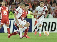 BOGOTÁ-COLOMBIA-20-05-2015. Daniel Torres (Der) jugador del Independiente Santa Fe disputa el balon con Andres D'Alessandro (Izq) jugador de Internacional durante partido de ida entre Independiente Santa Fe de Colombia y Internacional de Porto Alegre Brasil por cuartos de final de la Copa Bridgestone Libertadores 2015 jugado en el estadio Nemesio Camacho El Campin de la ciudad de Bogota. / Daniel Torres (R) player of Independiente Santa Fe figths for the ball with Andres D'Alessandro (L) player of Internacional during the first leg match between Independiente Santa Fe of Colombia and Internacional of Porto Alegre, Brazil, for the final quarters of the Copa Bridgestone Libertadores 2015 played at Nemesio Camacho El Campin stadium in Bogota city.  Photo: VizzorImage/ Gabriel Aponte /Staff