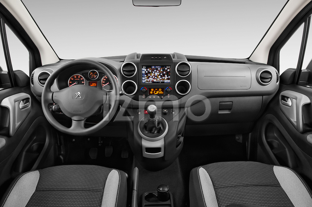 Stock photo of straight dashboard view of2015 Peugeot Partner Tepee Outdoor 5 Door Mini Mpv Dashboard