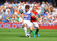 FAO SPORTS PICTURE DESK<br /> Pictured L-R: Ji-Sung Park of QPR challenged by Leon Britton of Swansea. aturday 18 August 2012<br /> Re: Barclay's Premier League, Queens Park Rangers v Swansea City FC at Loftus Road Stadium, London, UK.