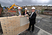 This image is free to use - Keith Brown  Minister for Housing and Transport  laid the foundation stone and visited the site of the major new Affordable housing development under construction for Queens Cross Housing Association at Oban Drive  Glasgow. With Mr Brown at the £14.28m 128 home site (formerly the North Kelvinside School) for the ceremony were John Gray (Chairman Queens Cross Housing Association) and Shona Stephen (Ch Exec Queens Cross Housing Association) and later met with Association committee members (see this pic) - for further information please contact Margaret Brannan (Communications Manager QXHA on 0141 589 7349 / 07791 461 154) - Picture by Donald MacLeod - 22.08.11 - 07702 319 738 - www.donald-macleod.com
