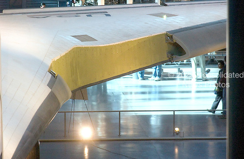 View of one of the wings of the Space Shuttle Enterprise at the  Smithsonian National Air and Space Museum Steven F. Udvar-Hazy Center in Chantilly, Virginia on December 11, 2004.  Portions of the leading edges of the wing are missing because the National Aeronautics and Space Administration (NASA) borrowed these leading edge panels, as well as the landing gear doors to aid in the Space Shuttle Columbia accident analysis.  This hardware was used in high-speed impact tests to determine the cause of tha accident, and it remains in use for return-to-flight testing..Credit: Ron Sachs / CNP.(RESTRICTION: NO New York or New Jersey Newspapers or newspapers within a 75 mile radius of New York City)