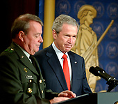 Washington, D.C. - February 9, 2006 -- United States President George W. Bush, center, is introduced by Brigadier General Robert V. Taylor, National Guard Association of the United States (NGAUS), left, prior to making remarks on the Global War on Terror at the National Guard Memorial Building in Washington, D.C. on February 9, 2006. <br /> Credit: Ron Sachs / CNP