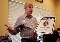 NWA Democrat-Gazette/DAVID GOTTSCHALK  Charles W. Adams, who prefers Chuck, retired Army National Guard major and head of the local Fayetteville/Springdale chapter of the Military Order of the Purple Heart, at his home in Fayetteville. After retiring from the military, Adams, was called into active duty for Operation Iraqi Freedom.
