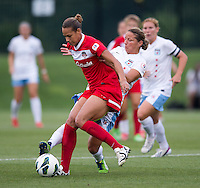 Toni Pressley (19) of the Washington Spirit keeps the ball away from Inka Grings (21) of the Chicago Red Stars during the game at the Maryland SoccerPlex in Boyds, Md.   Chicago defeated Washington, 2-0.