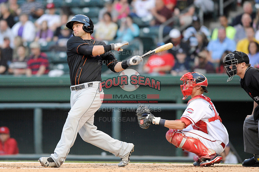 First baseman Christian Walker (23) of the Delmarva Shorebirds gets a hit in the third inning of a game against the Greenville Drive on  Friday, April 26, 2013, at Fluor at the West End in Greenville, South Carolina. Walker played for the National Champion University of South Carolina Gamecocks. He is listed as the No. 12 prospect of the Baltimore Orioles, according to Baseball America. He was a fourth-round draft pick in 2012.