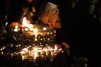 Paris, Frankrike, 15.11.2015. A man visits Place de la Republique to light candles for the victims. Images from Paris in the aftermath of the devastating terror attacks on friday november 13. Photo: Christopher Olssøn.
