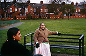 A Hindu woman sits on a bench  in Leicester, UK...Leicester has the biggest Gujarati population outside India and is expected to be the first city in the UK to have a majority non-white population within the next few years. It is one of the most ethnically-diverse cities in Europe. ....Picture taken April 2005 by Justin Jin