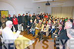 Liam Walsh address the crowd last Thursday night in The Seanchaí for a special community meeting about proposed cuts to the Community Employment Scheme.