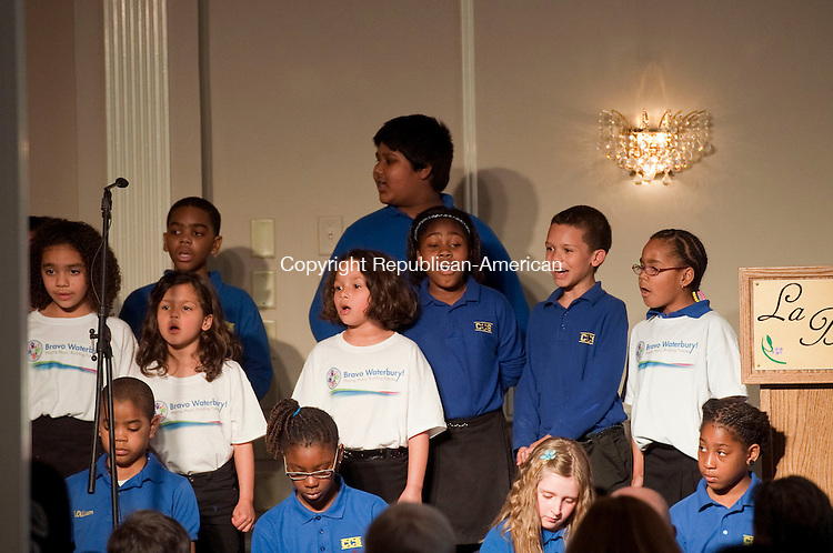 WATERBURY, CT 09 APRIL 2013--040913JS10-- Members of the Children's Community School's chorus sing to guests at the Children's Community School's annual dinner Tuesday at La Bella Vista and the Ponte Club in Waterbury. .Jim Shannon Republican-American.