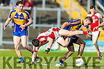 Adrian Spillane Kenmare in action against Paul Murphy Rathmore in the Senior County Football Semi Final in Fitzgerald Stadium on Sunday.
