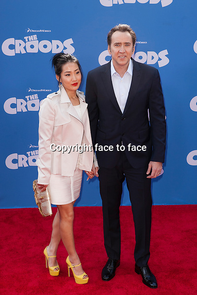Nicolas Cage and wife at the premiere of The Croods at AMC Loews Lincoln Square on March 10, 2013 in New York City...Credit: MediaPunch/face to face..- Germany, Austria, Switzerland, Eastern Europe, Australia, UK, USA, Taiwan, Singapore, China, Malaysia and Thailand rights only -