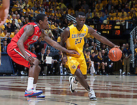 Jabari Bird of California controls the ball away from Arizona defender during the game at Haas Pavilion in Berkeley, California on February 1st, 2014.  California Golden Bears defeated Arizona Wildcats, 60-58.