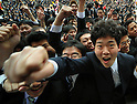 February 8, 2012, Tokyo, Japan - A throng of professional school students swarms to the stage at the climax of a send-off rally on Wednesday, February 8, 2012..Although Japans jobless rate in December 2011 improved 0.1 point from November to 4.6 percent, still 2.75 million Japanese are jobless. An estimated 203,000 students are due to graduate professional schools in March, of which roughly 52 percent have found some kind of jobs or another, according to the government stats. (Photo by Natsuki Sakai/AFLO) AYF -mis-.