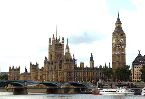"London, GBR - August 7, 2005 -- The Palace of Westminster, home to the two British houses of Parliamant, the House of Commons and the House of Lords,  in London, Great Britain, on August 7, 2005.  The tower at the left, center of the frame is the Victoria Tower.  At the right is the Clock Tower of the Palace of Westminster, popularly known as ""Big Ben"".  This view is from a ferry in the middle of the Thames River.  .Credit: Ron Sachs / CNP"
