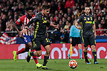Atletico de Madrid's Thomas Teye and Juventus' Paulo Dybala during UEFA Champions League match, Round of 16, 1st leg between Atletico de Madrid and Juventus at Wanda Metropolitano Stadium in Madrid, Spain. February 20, 2019. (ALTERPHOTOS/A. Perez Meca)