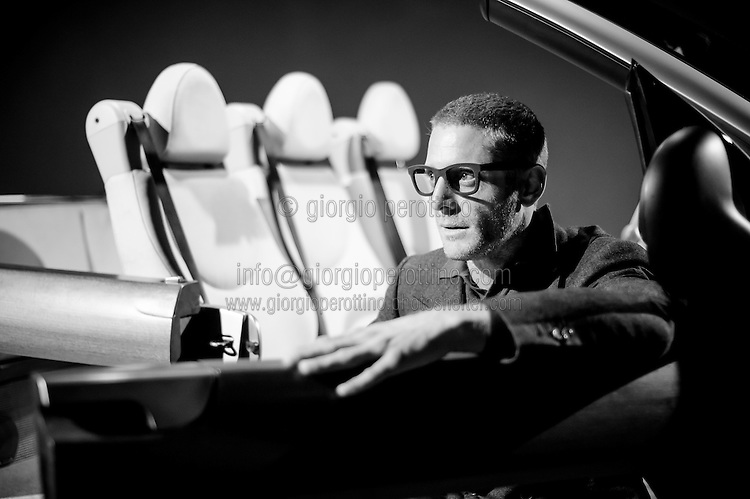 Lapo Elkann sits on one of his Grandfather Giovanni Agnelli's cars at the Car Museum of Turin, Italy, March 12, 2013.