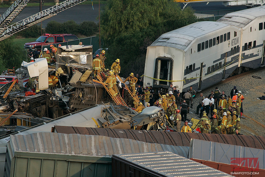 LOS ANGELES,CA - SEPTEMBER 12,2008: Rescue teams work to pull people from mangled commuter train, scene of fatal train crash in Chatsworth, September 12, 2008.