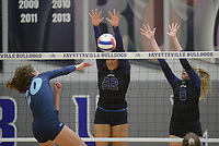NWA Democrat-Gazette/ANDY SHUPE<br /> Har-Ber's Lauren Thompson (20) sends the ball over the net as Fayetteville's Haley Warner (32) and Lyndsey Mylius defend Wednesday, Sept. 13, 2017, during play in Bulldog Arena. Visit nwadg.com/photos to see more photographs from the match.