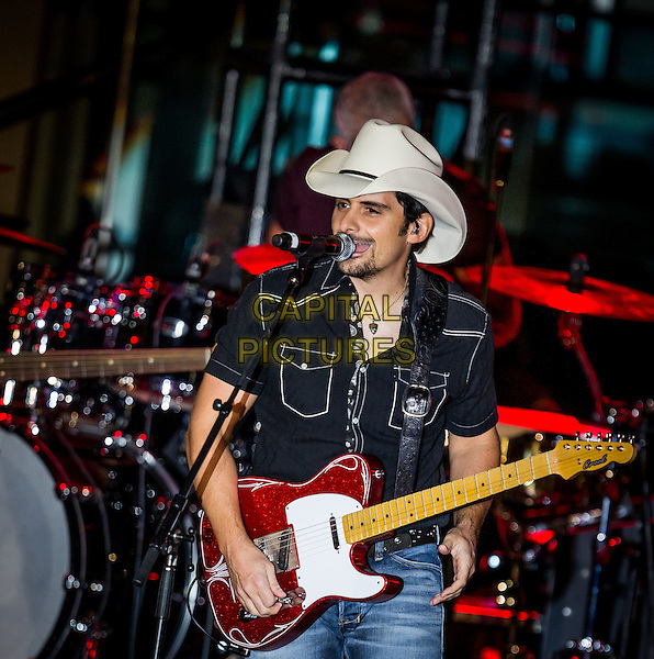 LAS VEGAS, NV - August 27: Brad Paisley performs at MoonShine In The Trunk Album Release Party The Boulevard Pool at The Cosmopolitan of Las Vegas in Las Vegas, NV on August 27, 2014.  <br /> CAP/MPI/RTNKabik<br /> &copy;RTNKabik/MediaPunch/Capital Pictures