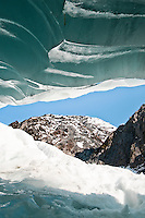 Views out of a beautifully shaped ice cave on Franz Josef Glacier -  Westland National Park, West Coast, New Zealand